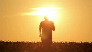 stock-footage-silhouette-of-a-man-at-sunrise-silhouette-of-a-man-walking-at-sunrise
